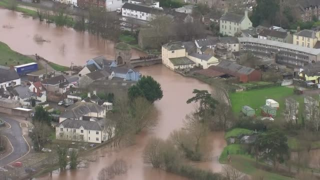 flooding continues to cause misery across the country wales monmouth swollen river wye air view / aerial swollen river wye and flooding over adjacent... - wales stock videos & royalty-free footage