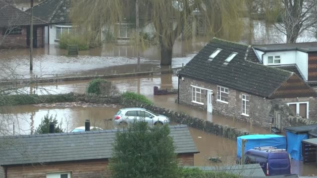 flooding continues to cause misery across the country; england: herefordshire: ext view over flooded countryside floodwater around house flooded road... - herefordshire stock videos & royalty-free footage