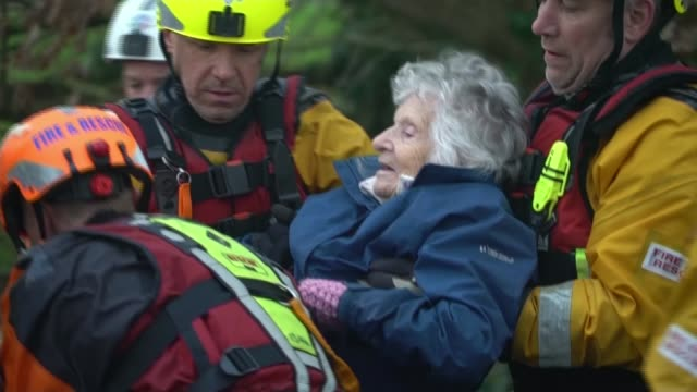flooding continues to cause misery across the country; england: herefordshire: whitchurch: ext firefighters pulling rescue boat along flooded road... - herefordshire stock videos & royalty-free footage