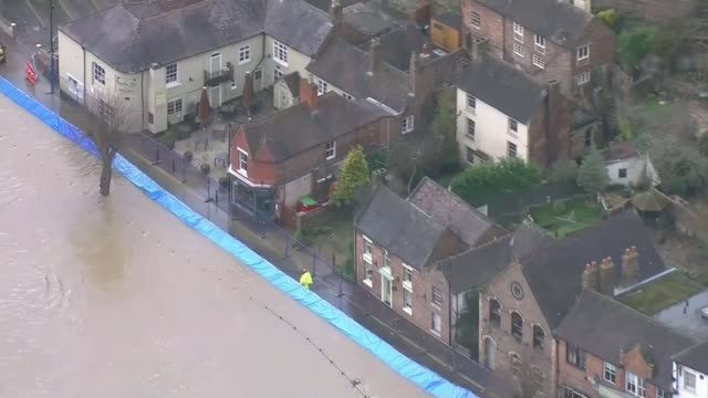 flooding continues to cause misery across the country; england: shropshire: ironbridge: ext air views flood defences along bank of river in... - ironbridge shropshire stock videos & royalty-free footage
