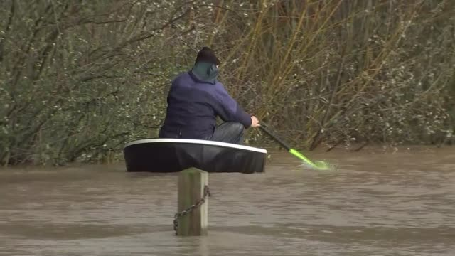 monmouth flood scenes wales monmouth ext flooded trees and buildings / man entering flooded subway on boat / man paddling/rowing along flooded river... - wales stock videos & royalty-free footage