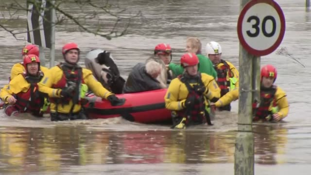 more than one month of rains falls in 48 hours in wales wales rhondda cynon taf treforest rescue workers along through flood water with elderly... - wales stock videos & royalty-free footage