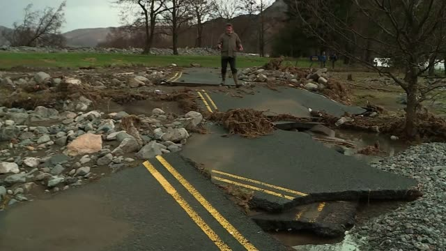 cumbria floods: clean-up begins; flood waters flowing around ullswater lake flood waters flowing by cafe and bench flood waters in submerged car park... - doorway stock videos & royalty-free footage