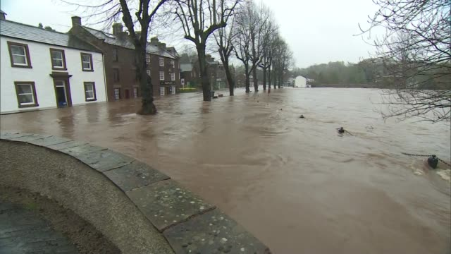 flooding and disruption / elderly man dies after being blown into path of bus day flooded river eden flowing pan water flowing down road and river... - リチャード・パロット点の映像素材/bロール