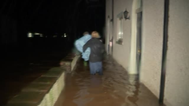 flooding and disruption / elderly man dies after being blown into path of bus england cumbria appleby rescue workers unloading bags rescue worker... - リチャード・パロット点の映像素材/bロール