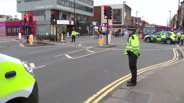 flooding and disruption / elderly man dies after being blown into path of bus; england: london: ext police officers at scene of incident where man... - リチャード・パロット点の映像素材/bロール