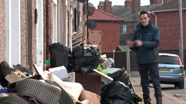 will insurance cover the damage; england: cumbria: carlisle: ext street of terraced houses with flood damaged belongings and furniture piled up... - wooden floor stock videos & royalty-free footage