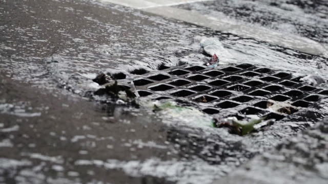 storm drain closeup during a new york city thunderstorm - sidewalk gutter stock videos & royalty-free footage