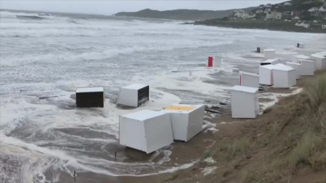 storm ellen brings heavy rain and gales to much of western britain; england: devon: woolacombe: ext beach huts swept up onto beach by waves during... - rain stock videos & royalty-free footage