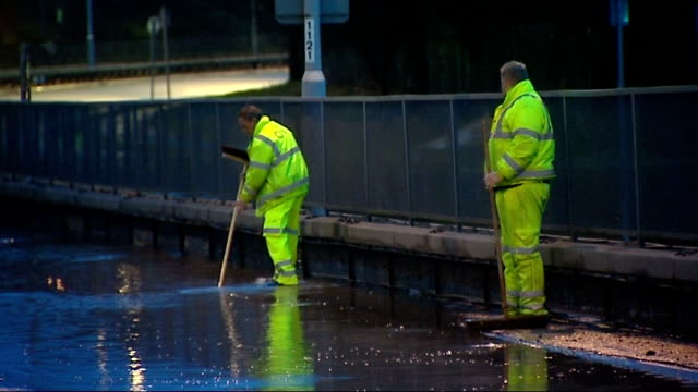 flooded road in eltham england london eltham morning 'london highways alliance' van with flooded road in background / highway maintenance workers... - 2013 stock videos & royalty-free footage