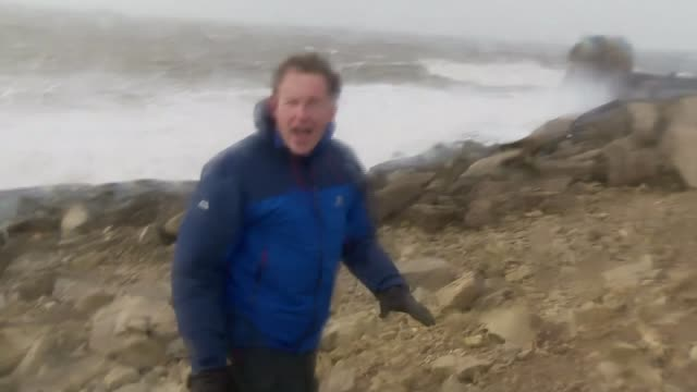 storm imogen batters southern britain; dorset: portland bill: reporter to camera - extreme weather stock videos & royalty-free footage