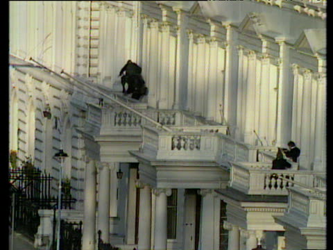 sas storm iranian embassy to end siege causing explosion at front of building london 05 mar 80 - belagerung stock-videos und b-roll-filmmaterial