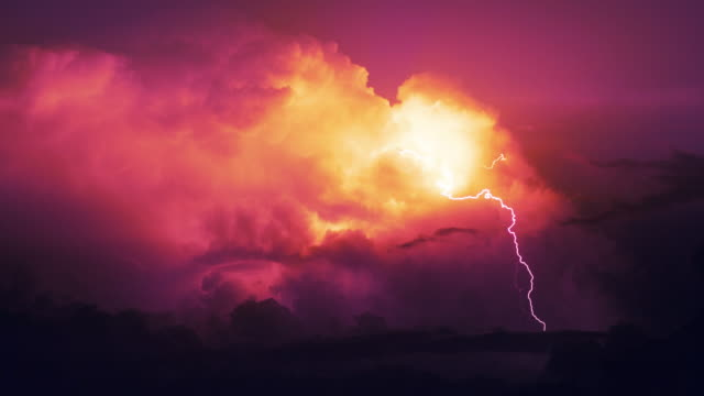 storm on a rocky coast. lightning - red cloud sky stock videos & royalty-free footage