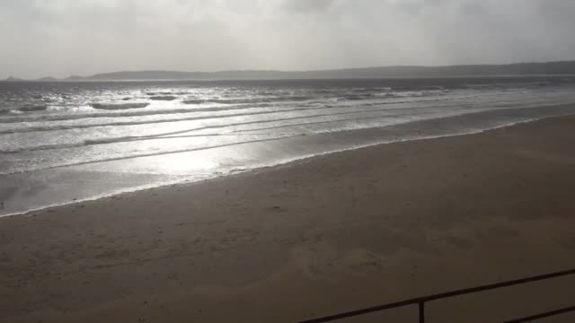Storm Ophelia hits the seafront at Swansea Bay An amber severe weather warning covers most of Wales