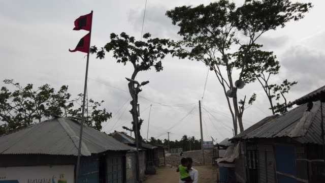 storm signal flag is seen in the coastal areas. coastal areas currently home to 300 million people will be vulnerable by 2050 to flooding made worse... - flag of bangladesh stock videos & royalty-free footage