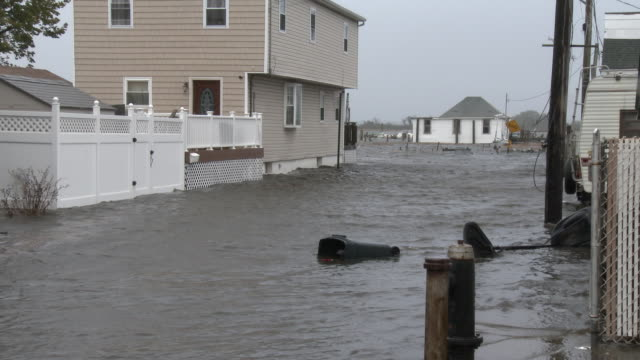 Storm surge inundates Broad Channel New York and surrounds residential homes as a powerful nor'easter hits the area