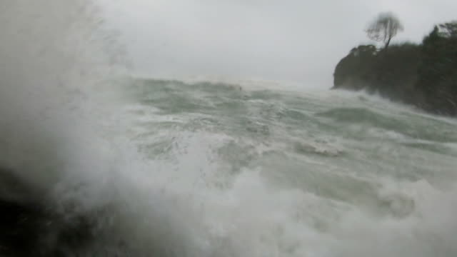 storm surge waves and powerful hurricane winds lash camera as typhoon hagibis hits japan - 集中豪雨点の映像素材/bロール