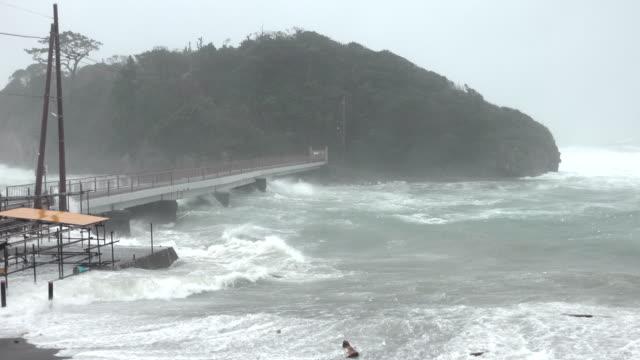 storm surge waves swamp small fishing harbor as typhoon hagibis hits japan - cyclone stock videos & royalty-free footage