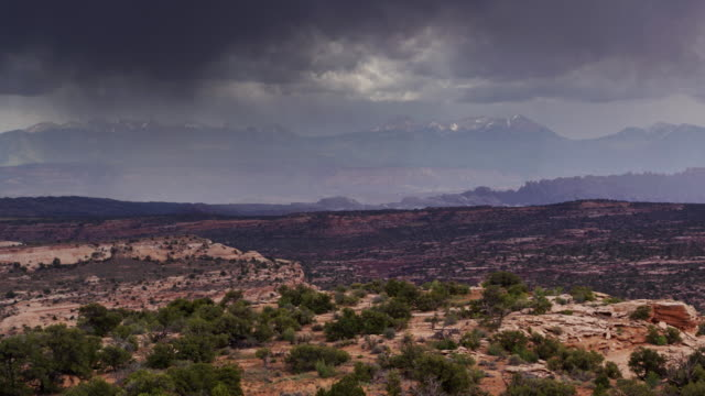storm sweeping across la sal mountains - drone shot - moab utah stock videos & royalty-free footage