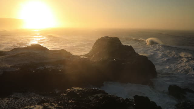storm waves at cape dyrholaey in iceland. stormy sunrise - dyrholaey stock videos & royalty-free footage