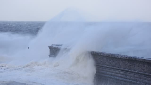 storm waves battering whitehaven harbour from an extreme low presure system. cumbria, uk, 10th december 2014. - boulder rock stock videos & royalty-free footage