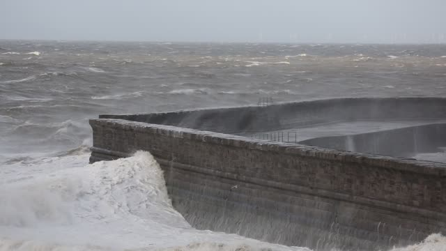 storm waves battering whitehaven harbour from an extreme low presure system. cumbria, uk, 10th december 2014. - boulder stock videos & royalty-free footage
