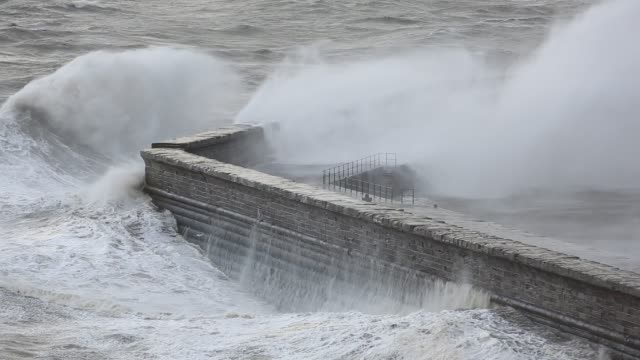 storm waves battering whitehaven harbour from an extreme low presure system. cumbria, uk, 10th december 2014. - weather stock videos & royalty-free footage