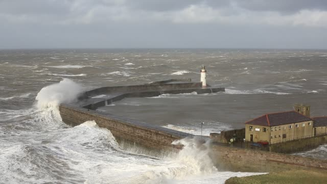 Storm waves battering whitehaven harbour from an extreme low presure system. Cumbria, UK, 10th December 2014.