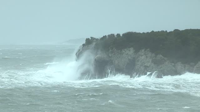 Storm waves from Hurricane Irene crash into the rocky coastline in Jamestown, Rhode Island.