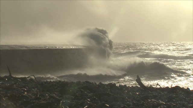storm winds and waves hitting sea defence - power in nature stock videos & royalty-free footage