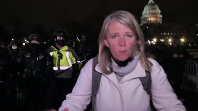 storming of us capitol: gvs protesters and riot police at night; usa: washington dc: capitol hill: vox pop trump supporter riot police towards as... - pushing stock videos & royalty-free footage