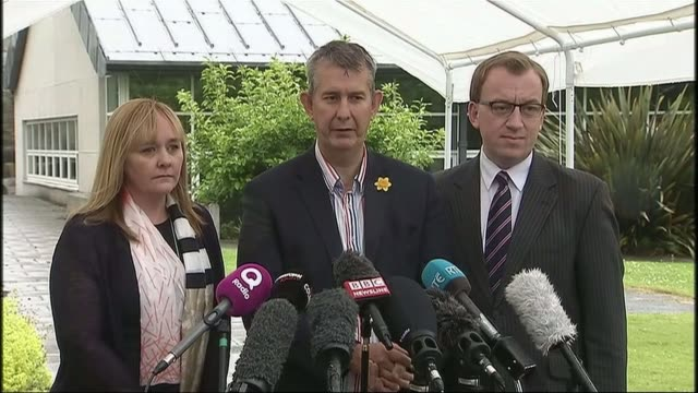 stormont power-sharing talks deadline pushed back; stormont castle: ext edwin poots and dup colleagues towards cutaway press at dup press conference/... - democratic unionist party stock videos & royalty-free footage