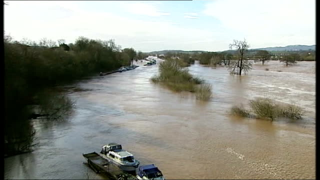 storms across southern and western britain / flooding england worcestershire ext flooded river severn with malvern hills in background pan river... - gloucestershire stock videos and b-roll footage