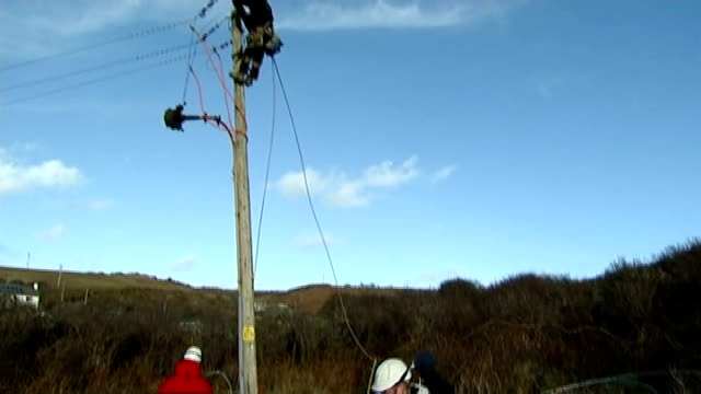 storms across southern and western britain / flooding wales pembrokeshire nolton haven ext various of western power worker repairing electricity... - pembrokeshire stock videos and b-roll footage