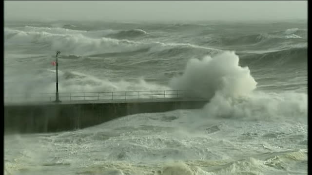 Storms and floods cause damage across Britain ENGLAND Cornwall Porthleven Sea crashing into shore High waves crashing against rocks Close shot...