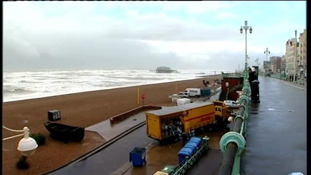storms batter britain: brighton seafront; england: sussex: brighton: ext general views of brighton seafront, including beach, brighton pier , stormy... - ブライトン パレスピア点の映像素材/bロール