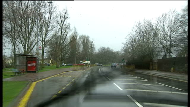Storms batter Britain disrupting travel and power Epsom S POINT OF VIEW along road to fallen tree at roadside EXT Fallen tree at roadside Reporter to...