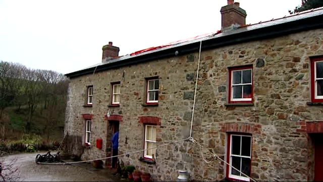 Storms batter Britain disrupting travel and power Solva Driveway leading up to farmhouse Back of farmhouse with tarpaulin covering hole in roof Front...