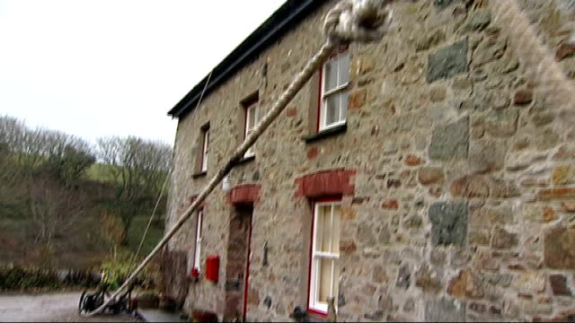 storms batter britain disrupting travel and power wales pembrokeshire stonebuilt cottages with slate roofs damaged by winds and storms hermione... - pembrokeshire stock videos & royalty-free footage