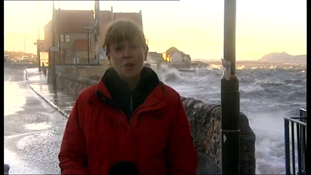 storms batter northern britain and northern ireland east lothian prestonpans heavy seas in bay seen from openened window reporter to camera heavy... - bay window stock videos & royalty-free footage