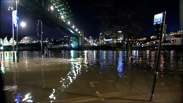 storms batter northern britain and northern ireland; england: tyne and wear: newcastle: night partial flood water on street with people in background... - county durham england stock videos & royalty-free footage