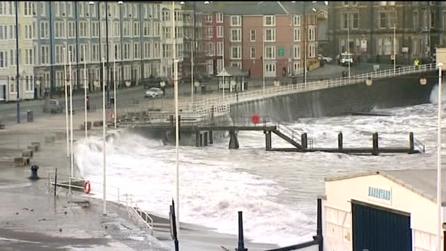 vídeos de stock, filmes e b-roll de more storms hit flooded south west britain wales aberystwyth waves crashing over sea wall - aberystwyth