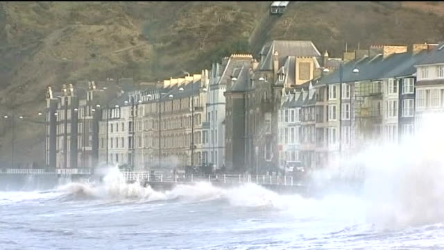 vídeos de stock, filmes e b-roll de more storms hit flooded south west britain wales aberystwyth large waves crashing against seafront various of choppy sea and giant waves crashing on... - aberystwyth