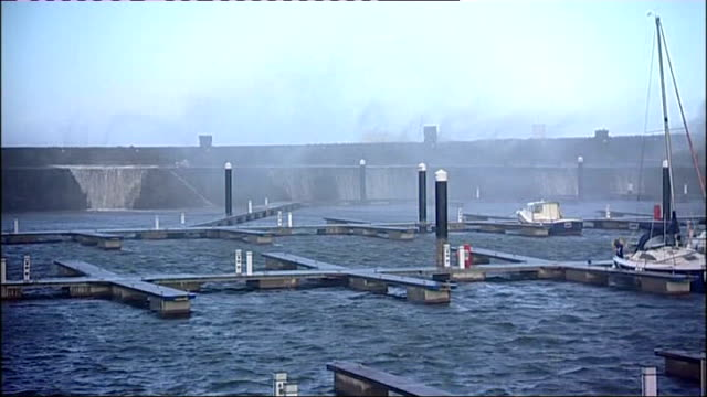 north east and cumbria scenes cumbria whitehaven general views of harbour with high wind blowing waves and seawater spray over harbour wall/ waves... - cumbria stock-videos und b-roll-filmmaterial