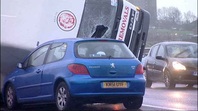 stockvideo's en b-roll-footage met north east and cumbria scenes england tyneside newcastleupontyne / gateshead ext various of overturned lorry on redheugh bridge road bridge with... - tyne and wear