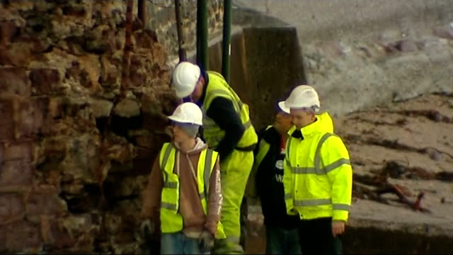 storms in south west england continue cornwall kingsand workers erecting makshift scaffolding poles at base of damaged clock tower - kingsand video stock e b–roll