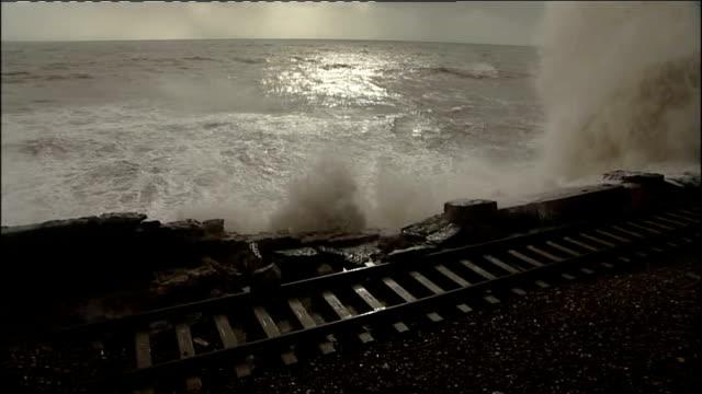 storms in south west england: dawlish railway line; national rail workmen surveying damage to track / waves crashing over damaged track / damaged... - railway track stock videos & royalty-free footage
