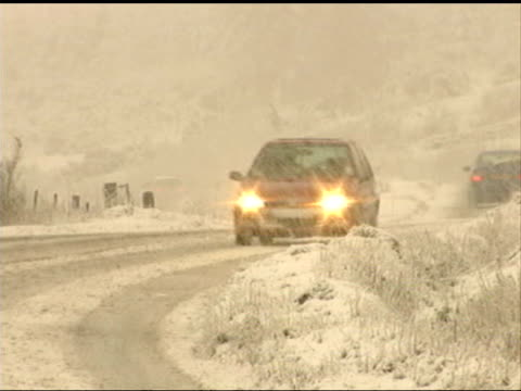 storms kill 11 people and cause countrywide destruction scotland perthshire sheep in snowcovered field as heavy snow falls car towards with... - perthshire stock videos & royalty-free footage
