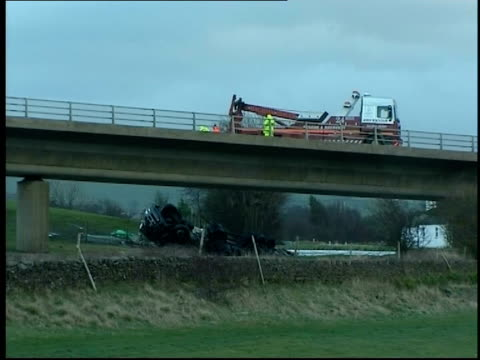 storms kill 11 people and cause countrywide destruction; yorkshire: skipton: recovery truck on bridge with overturned lorry crashed on ground below... - スキップトン点の映像素材/bロール