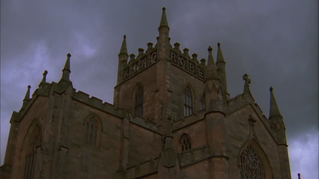 Stormy clouds drift above Dunfermline Abbey in Fife, Scotland. Available in HD.